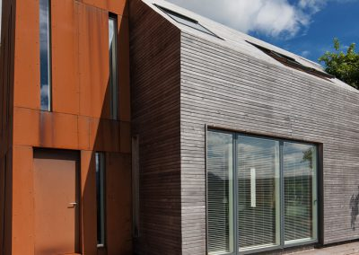 Corten tower and timber clad extension to existing farmhouse (photography: David Barbour)